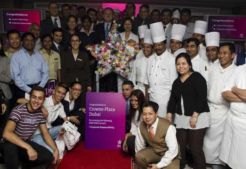 Crowne Plaza staff celebrate with enviro-stars