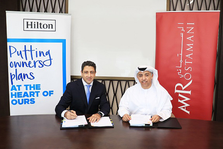 Hilton and AW Rostamani Group sign management agreement