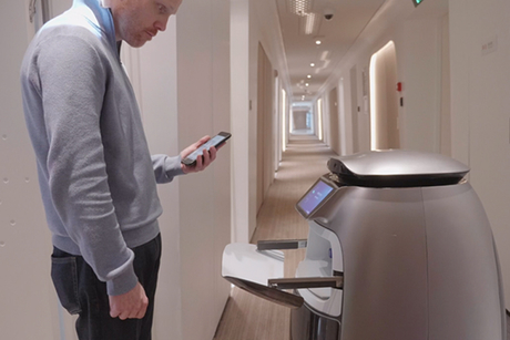 Robots deliver water, pillows at Alibaba Group's new futuristic hotel - FlyZoo