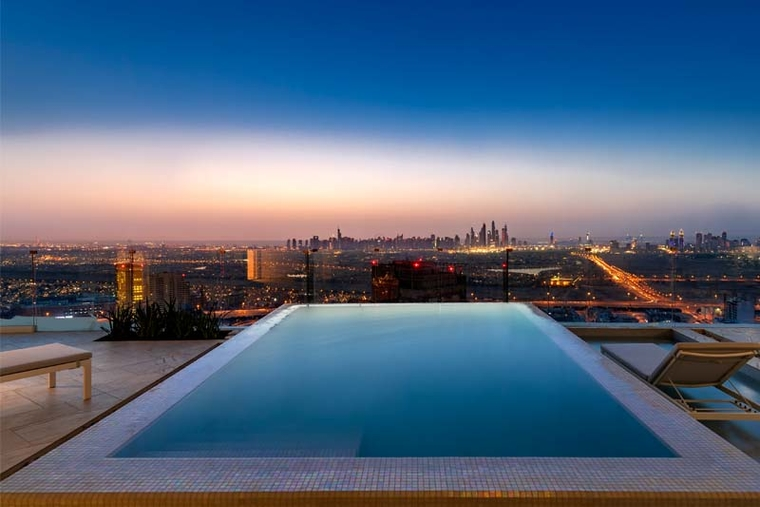 Views of the Dubai skyline from a private pool.