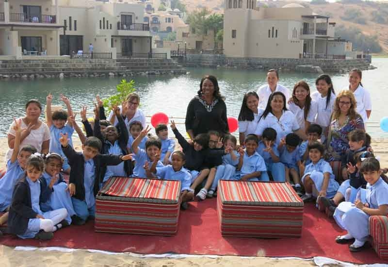 Students with the Cove Rotana team.