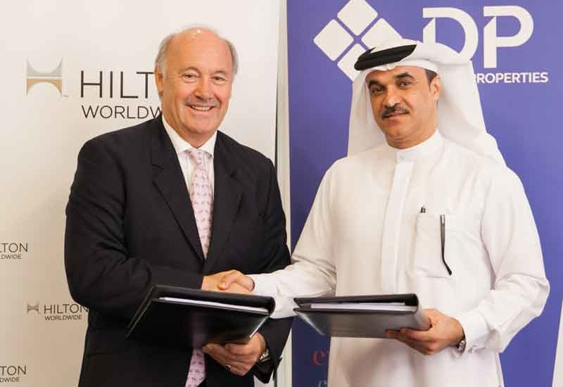 Rudi Jagersbacher, president, Middle East & Africa, Hilton Worldwide and Mohammed Al Habbai, chief officer of urban planning and infrastructure, Dubai Properties Group, sign the agreement to open the DoubleTree by Hilton Dubai Business Bay.