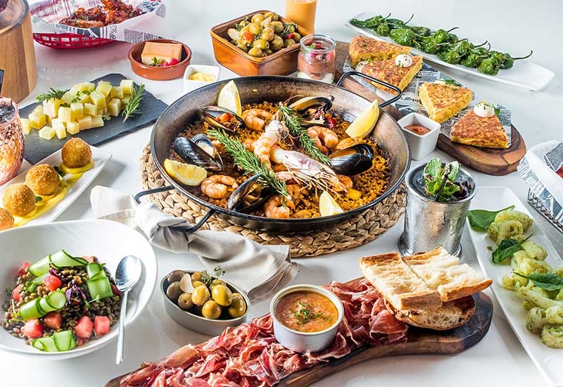 A spread of traditional Spanish dishes at El Sur.