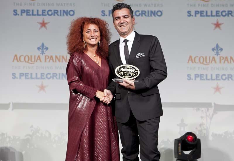 Stefano Viola accepts the F&B Manager of the Year award on behalf of Ksenia Novikova.