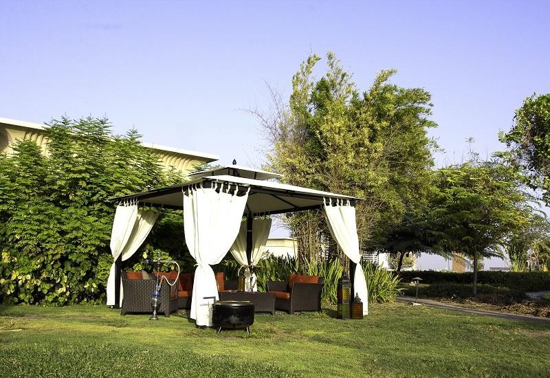 Open air cabana at Raffles Garden.