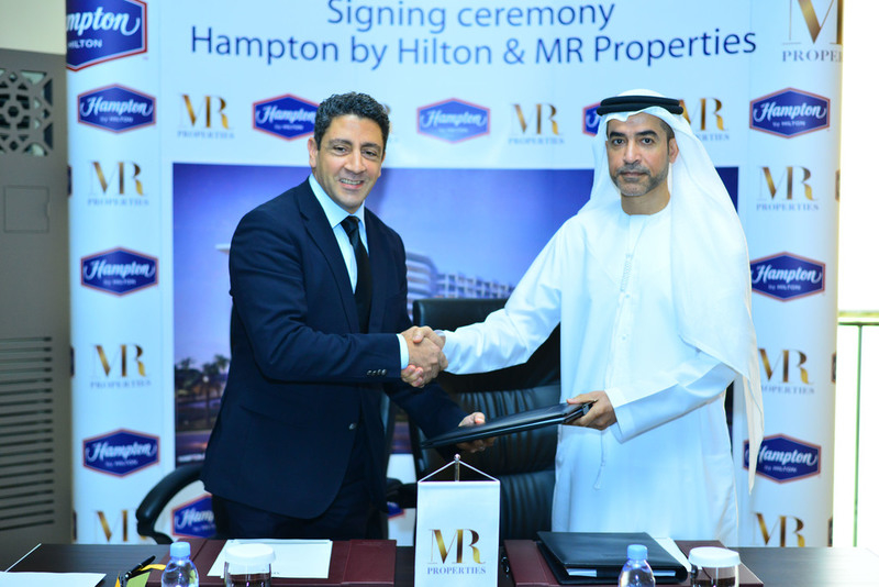 Hilton vice president of development MENA Carlos Khneisser (left) with MR Properties chairman Mohamed Ruqait during the management agreement signing of Hampton by Hilton Al Marjan Island in Ras Al Khaimah.