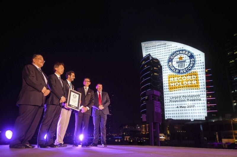 Accepting the Guinness World Record award were Panasonic Panasonic managing director Hiroki Soejima, marketing Middle East Yasuo Yamasaki, IHG Dubai regional general manager and InterContinental Hotels Dubai Festival City area general manager James Koratzopoulos and Al-Futtaim Group Real Estate director of shopping centres Dubai Steven Cleaver.