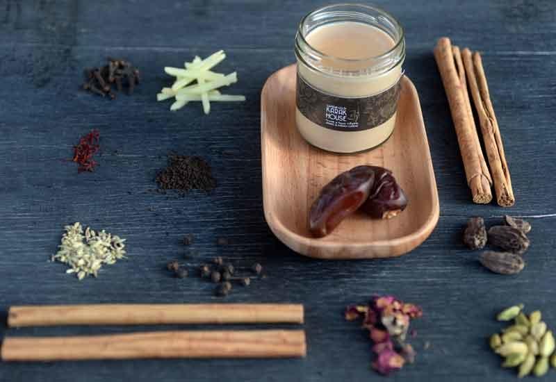 Karak Chai is served in mini jars.
