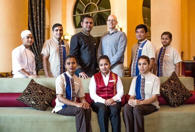 Craig Cochrane, senior VP human resources, Movenpick Hotels & Resorts with  Right4Children graduates currently working at Mövenpick Hotel Ibn Battuta Gate, Dubai.