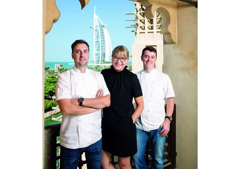 Nick Alvis, Viktorija Paplauskiene and Scott Price on Folly's terrace, overlooking the Burj Al Arab.