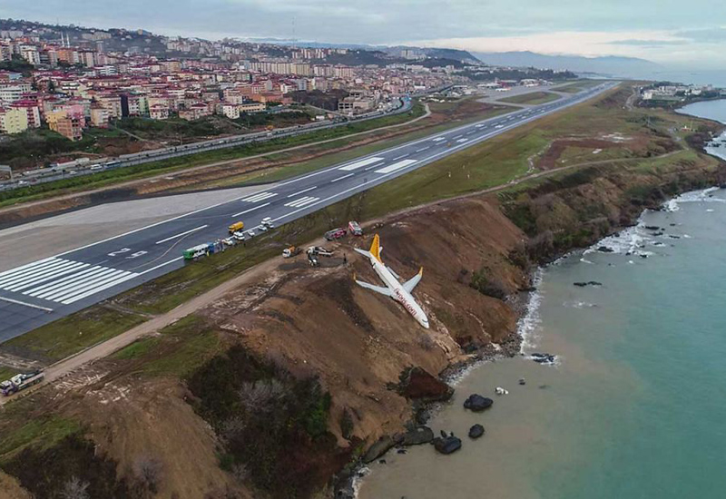 A Pegasus Airlines Boeing 737 passenger plane is seen struck in mud on an embankment, a day after skidding off the airstrip, after landing at Trabzon's airport on the Black Sea coast on January 14, 2018.