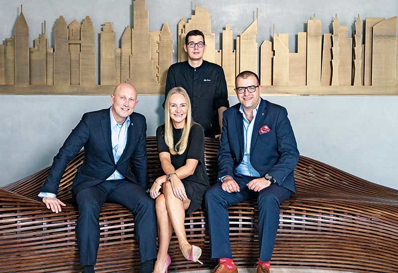 The ExCom team - (seated) general manager Rick Zeolla, director of sales and marketing Jeannette Smit, director of rooms Laith Naber, and (standing) director of culinary Gilles Perrin.