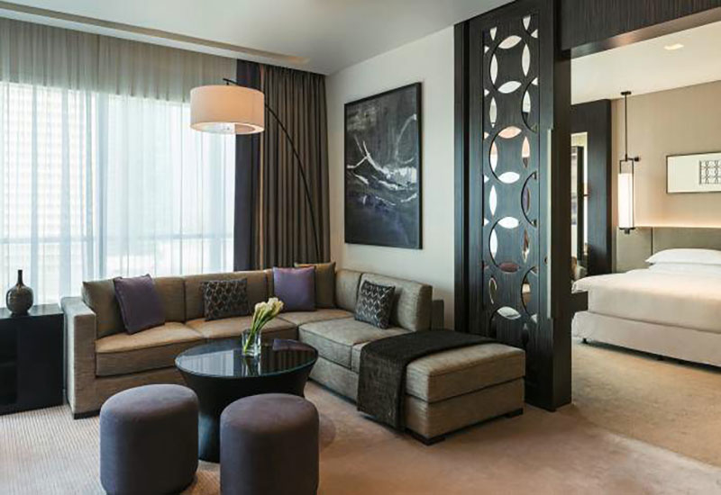 The deluxe suite offers a separate living area and bedroom.