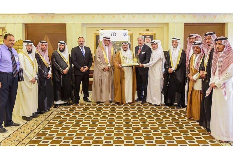 Prince Faisal bin Mishaal bin Saud (centre); to his left, Mohammed Al Shiha, CFO of Swiss International Middle East; to his right, Henri Kennedie, chairman of Swiss International Hotels & Resorts.