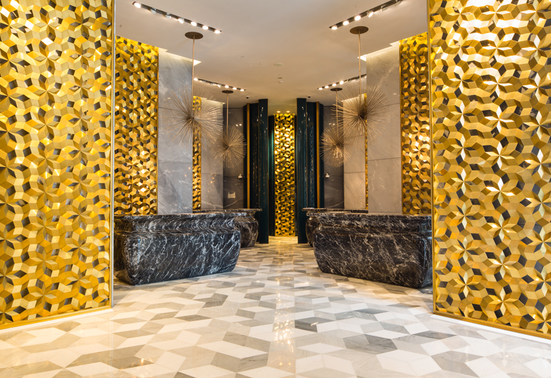 The lobby with gold honeycomb catacombs.