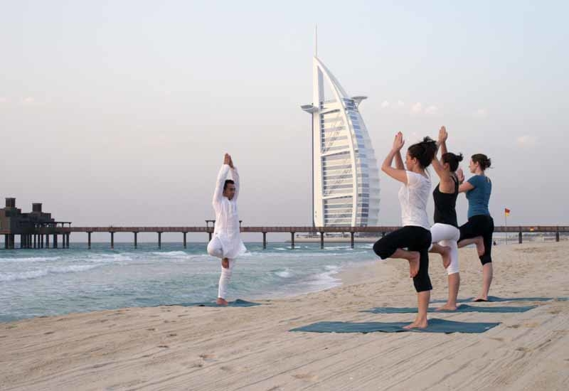 A complimentary yoga session on Madinat Jumeirah's private beach will be offered.