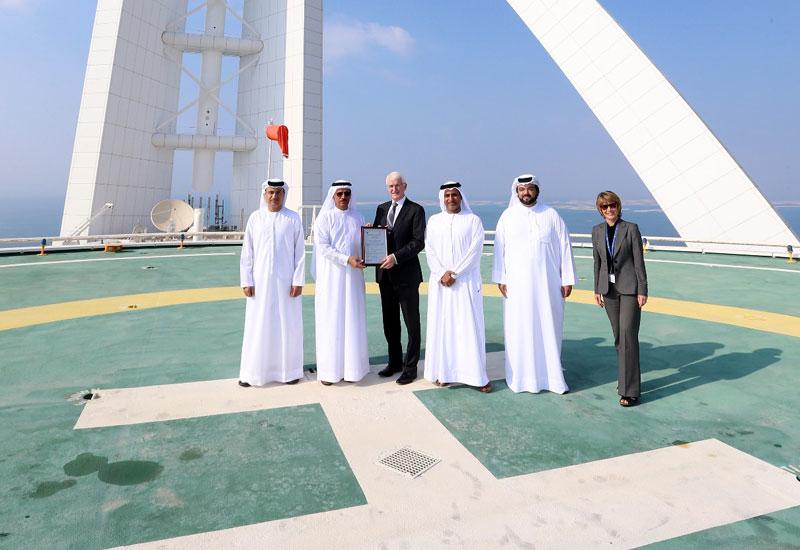 Gerald Lawless receives the license on the Burj Al Arab helipad [image: GCAA UAE]