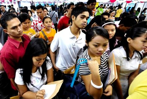Filipino workers queue for applications at a job fair hiring for overseas roles [image for illustrative purposes only]