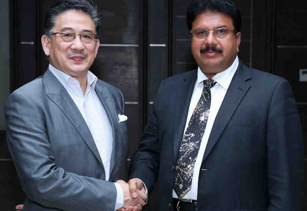 )  StayWell Hospitality Group CEO Simon Wan and VKL Group, Chairman Dr Varghese Kurian sign agreement.