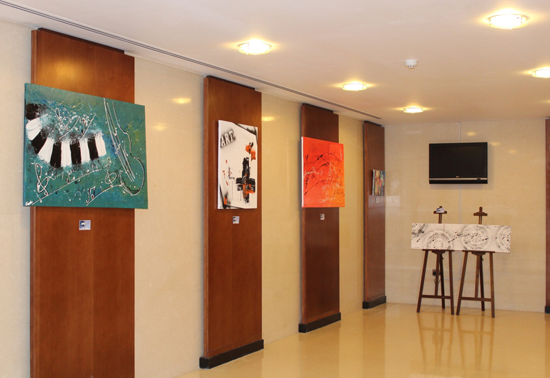 Art exhibit is being displayed in the hotel's lobby.