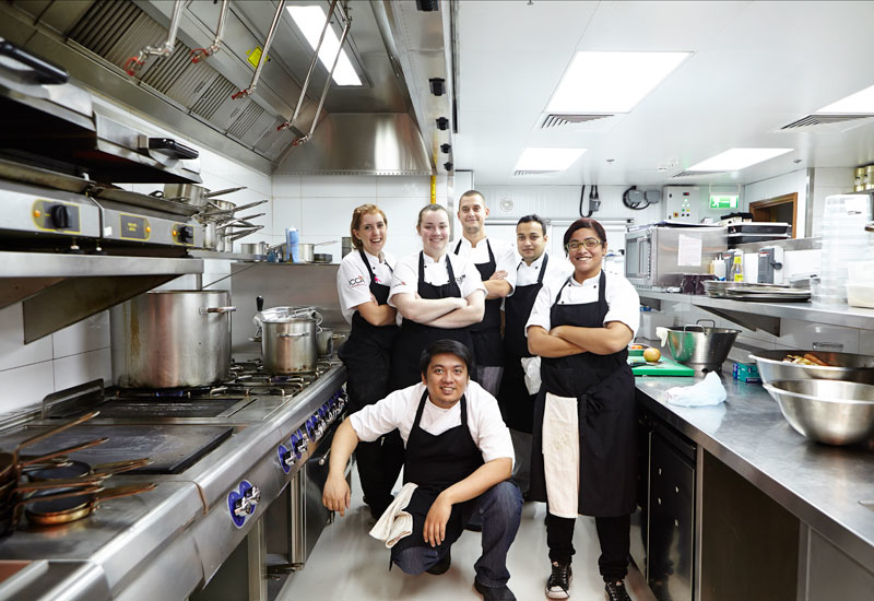 left to right: chef de partie Megan; head chef Amy Tomkinson; sous chef Andreas; commis chef Ankit; commis chef Gloria; chef de partie Panda.