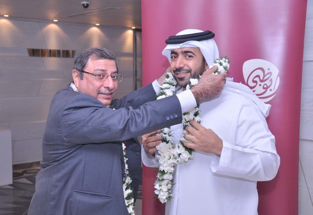 TCA Abu Dhabi international promotions manager Mubarak Al Nuaimi and Ben Dinshaw celebrate the opening of the new India office.