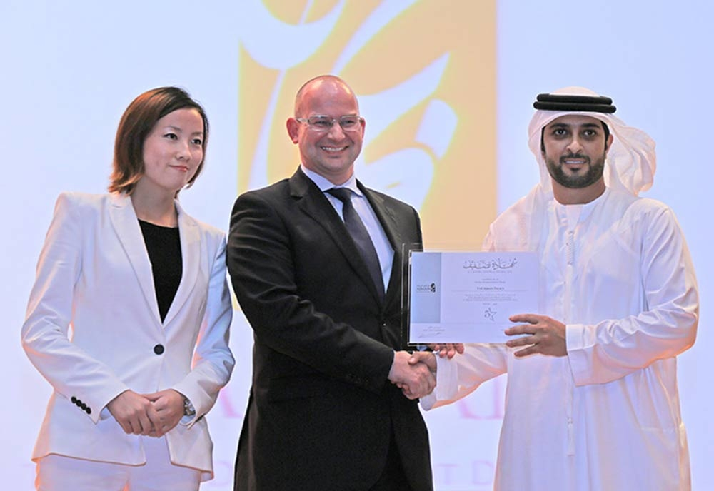 The Ajman Palace executive assistant manager Christian Huschka collects the hotel classification from the ATDD.