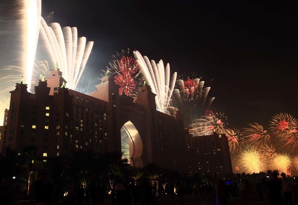 People watch the fireworks on the street outside Atlantis The Palm Dubai.
