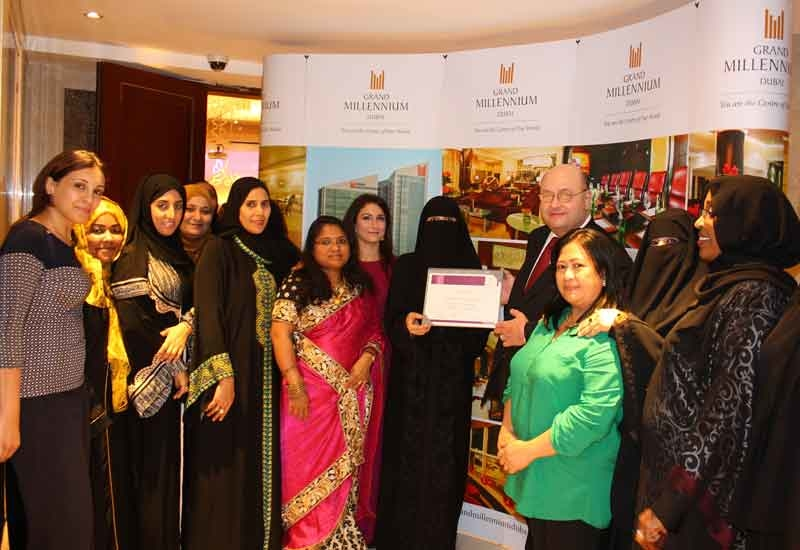 The Grand Millennium Dubai team with DFWAC residents.