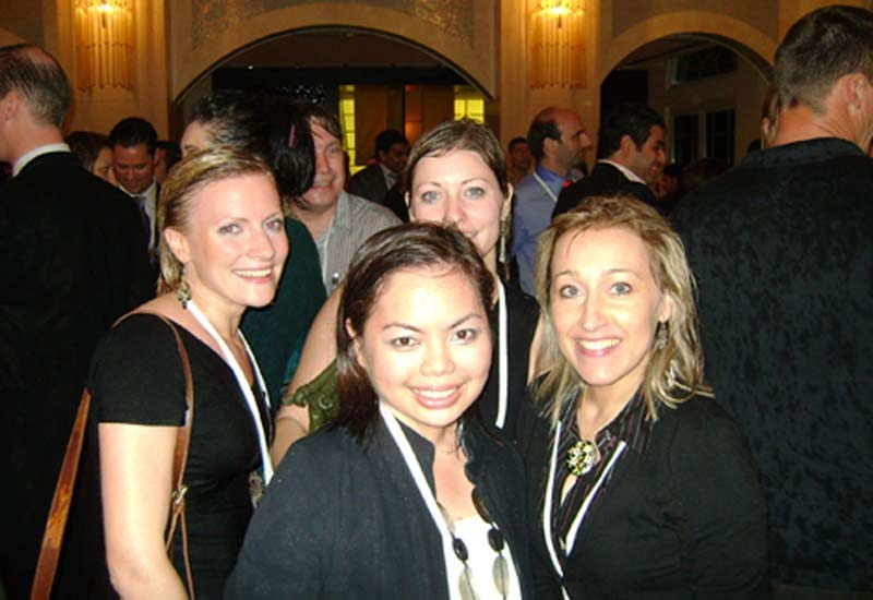 In from the rain: Hotelier's Louise Oakley and Caterer's Lucy Taylor take refuge behind Yasmine Hidalgo and Sonia Casonato from Renaissance Dubai.