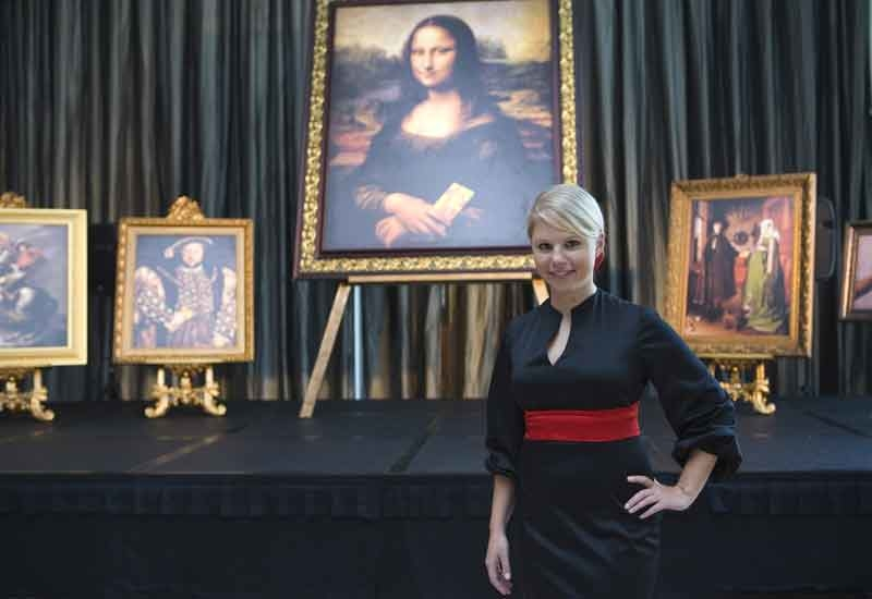 Nestle Professional's Mary-Ann Gardner, in front of the humorous replicas of Louvre paintings incorporating Maggi chicken bouillon.