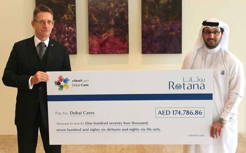 Rotana Hotels area vice president - Dubai and Northern Emirates, Thomas Tapken hands over the cheque to a Dubai Cares representative.
