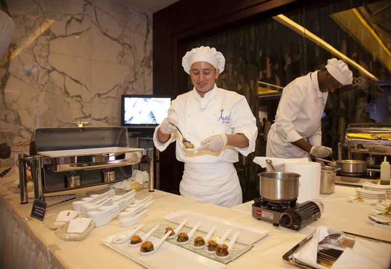 Chefs serve up gourmet appetisers at the show.