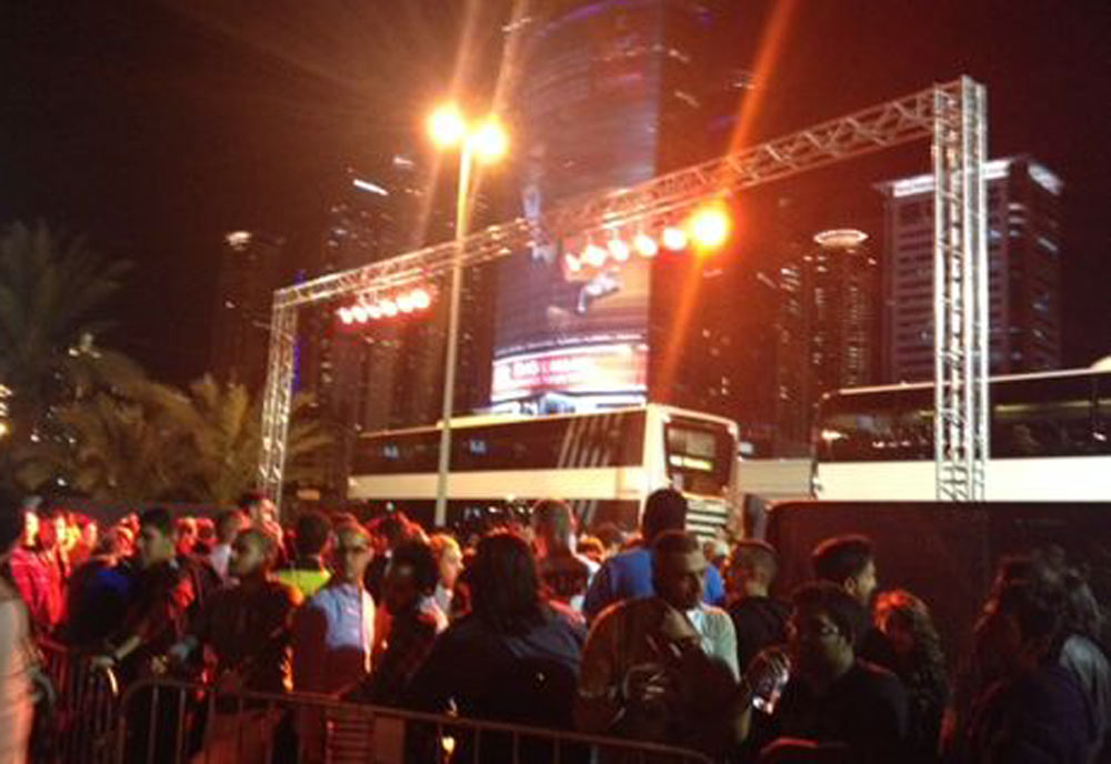 Revellers wait for the Sandance bus on New Year's Eve.