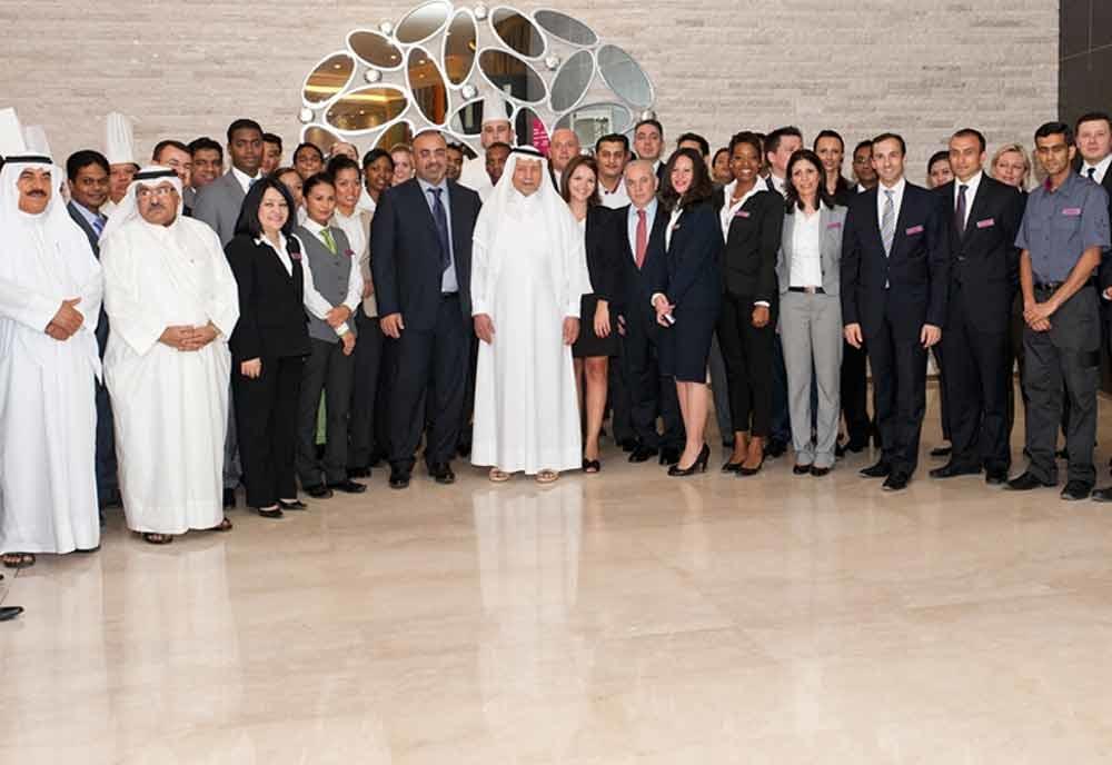 HE Sheikh Mohammed Bin Hamad Bin Abdullah Al Thani with the hotel staff