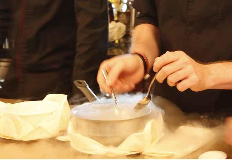 Sorbet is dropped into liquid nitrogen to create a gin/tonic nitro.