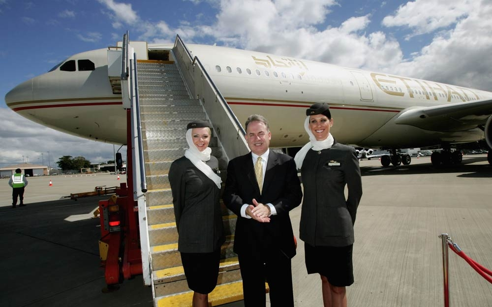 James Hogan, Etihad Airways CEO and crew members [Getty Images]..