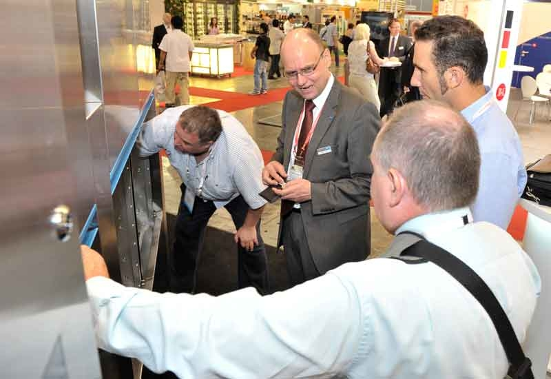 Lothar Hummel, regional manager, international sales shows off key features of the new M-iQ dishwasher at April's FHA