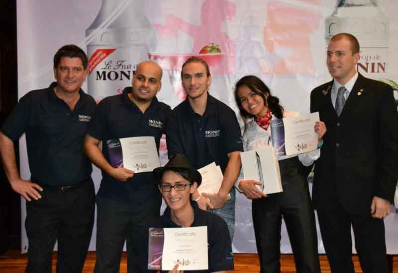 Monin's Jeremy Coulbeck (left) and Andrea Fidora (right) pose with contestants