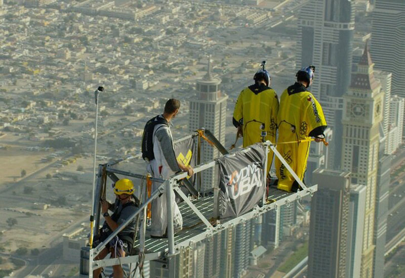 The base jumpers prepare for their leap [Image: twitter.com/skydivedubai]