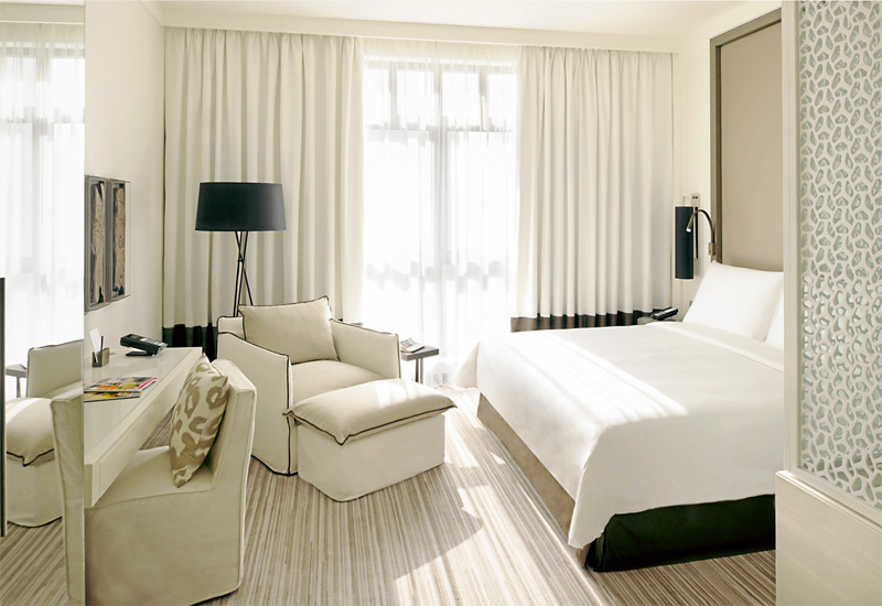 The Vida Deluxe Room, where natural light is emphasised and the Simmons and Muldorfer bed is a brand standard.
