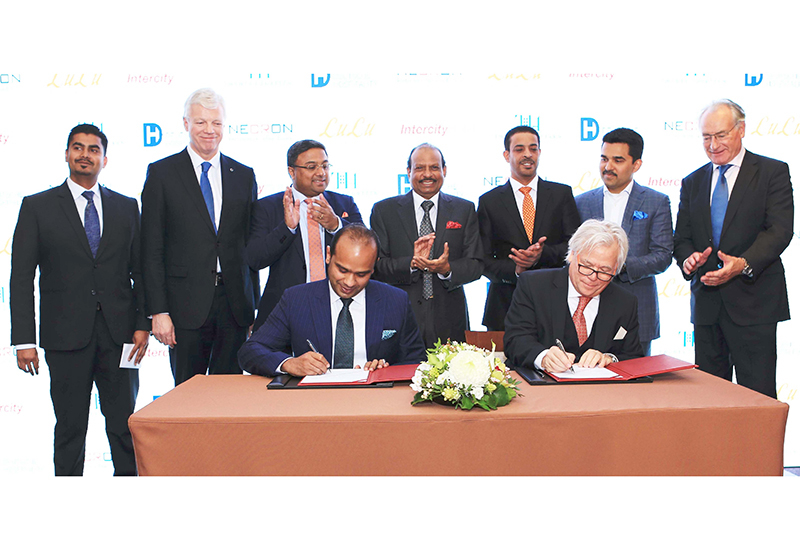 Twenty14 Holdings MD Adeeb Ahamed signing the agreement with Necron AG CEO Gerard van Liempt, in the presence of LuLu Group International chairman and managing director Yusuff Ali MA and Deutsche Hospitality CEO Thomas Willms