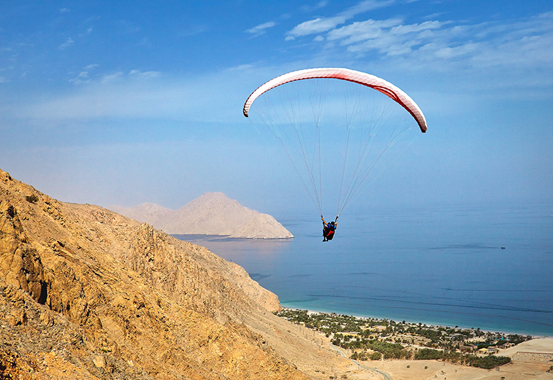 In Oman at Six Senses Zighy Bay, guests can arrive by air and paraglide into the 82 all-villa resort.