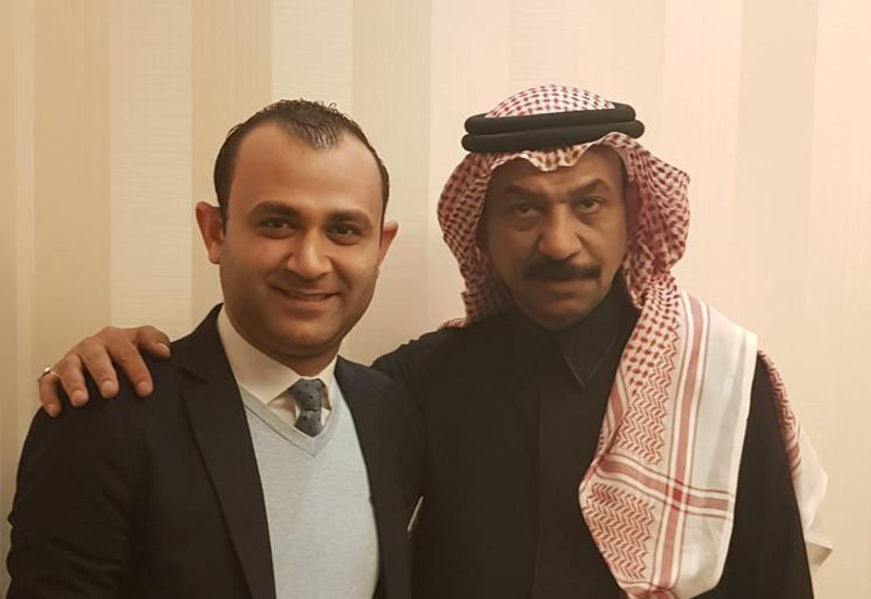 Abadi Jawhar with the assistant front office manager.