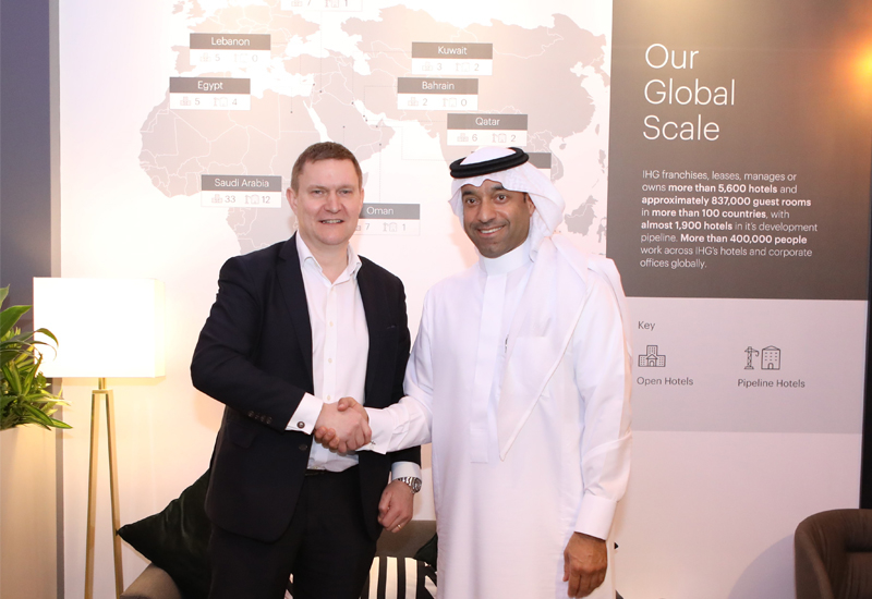 IHG's Kenneth Macpherson (left) and Loulouat Al Madinah Hospitality's Sami Al Hokair signing the franchise deal