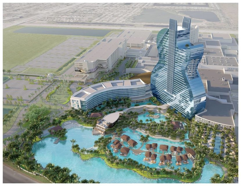 The guitar shaped hotel will feature some swim up suites