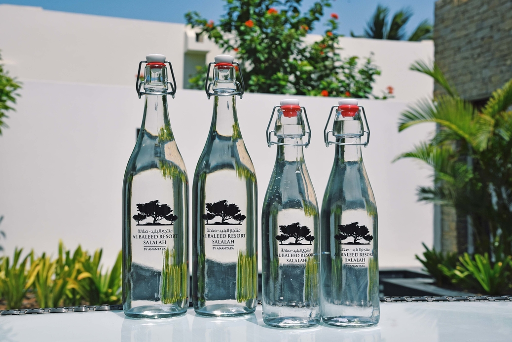 The resort provides guests with purified water in reusable glass bottles