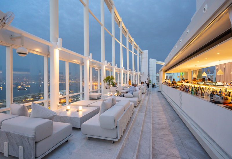 Design features include white coloured furniture, white marble, a refreshed pool and a long bar