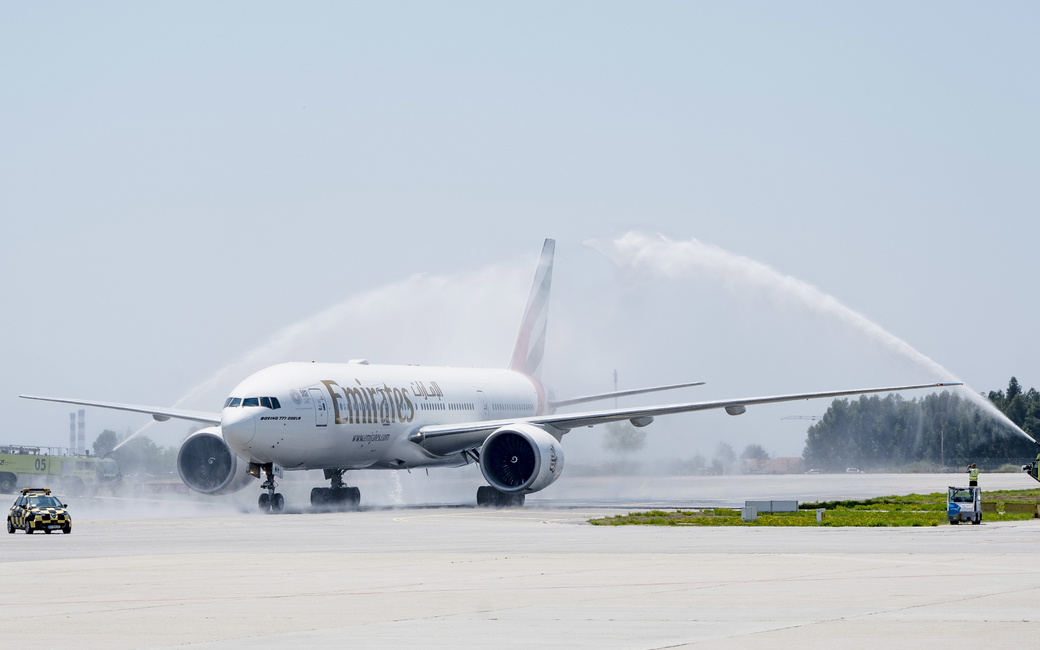 Emirates Boeing 777300ER is welcomed with a water cannon salute after touchdown at Porto Airport.