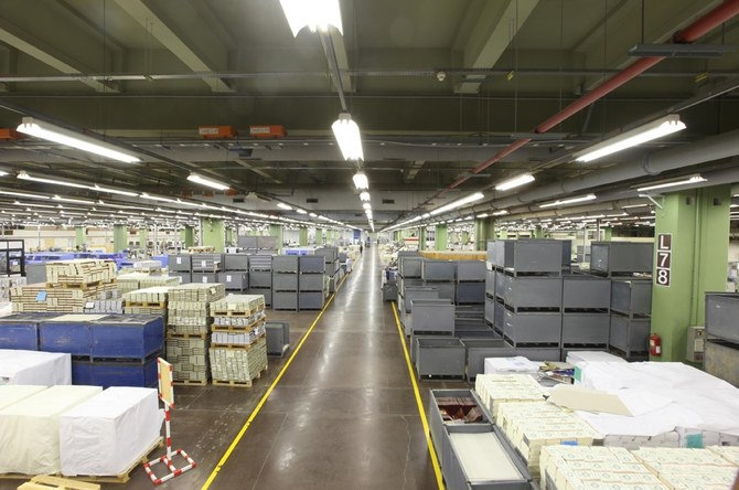 Copies of the Holy Qur'an are prepared for shipping at the King Fahad Complex